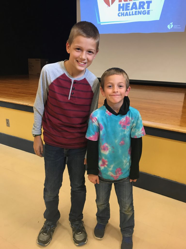 two boys in front of stage at school